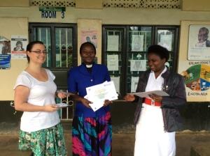 Rev Elizabeth proudly receives her USHAPE Family Planning Certificate