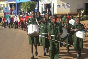 Teachers, school children and local leaders march through Kanungu town to celebrate the 1st Anniversary of the Pastoral Lead Network